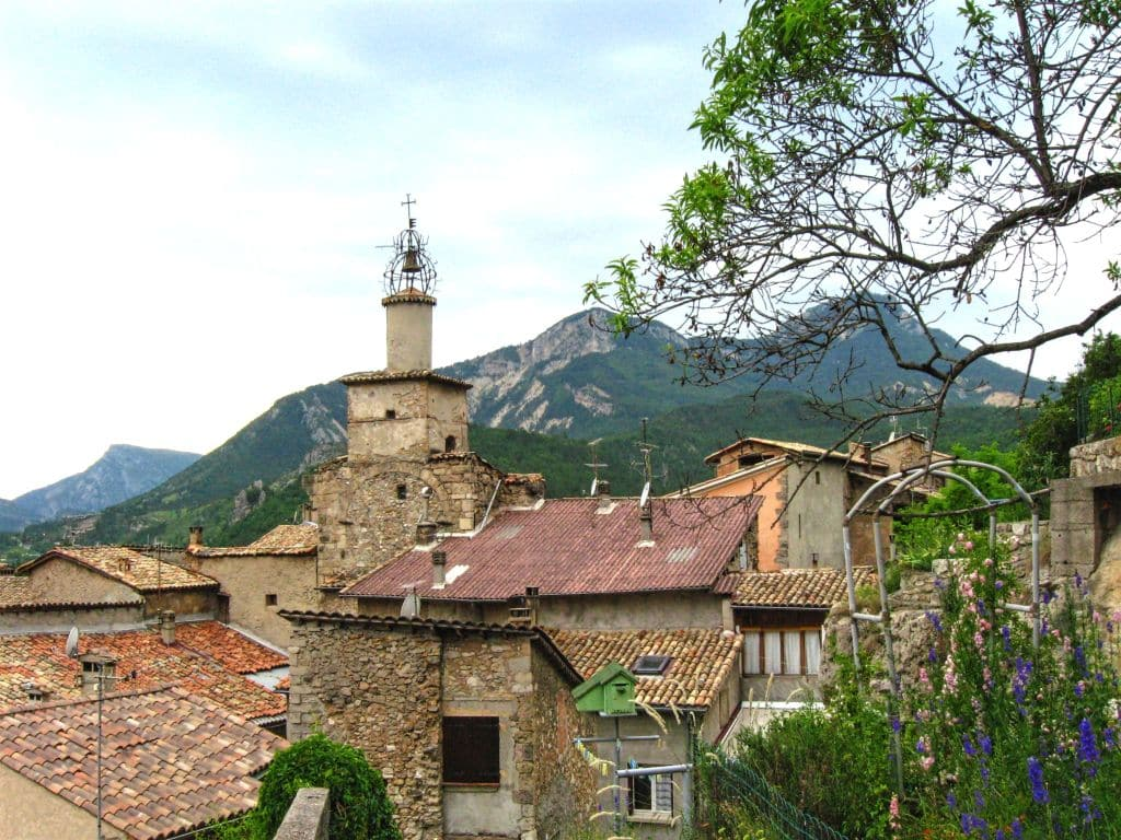 Castellane, Provence, red rooftops, church bellfy, mountains