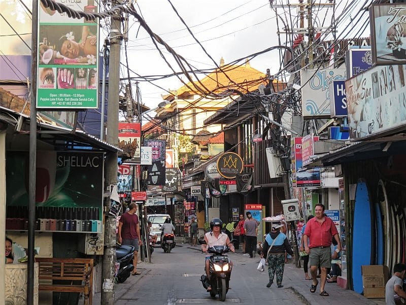 Kuta, Bali, Indonesia, busy street, hanging cables, shops