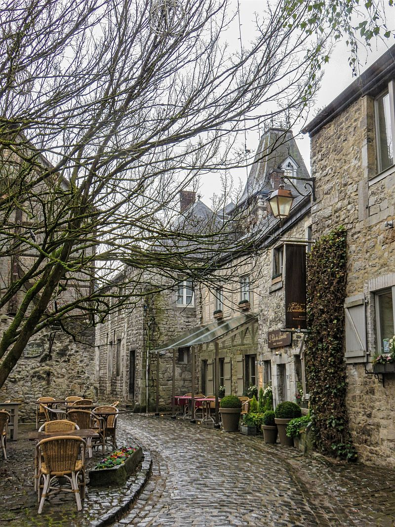 a street with cobblestone, old hoses, ivy walls, rainy day, Durbuy, Belgium, Wallonia