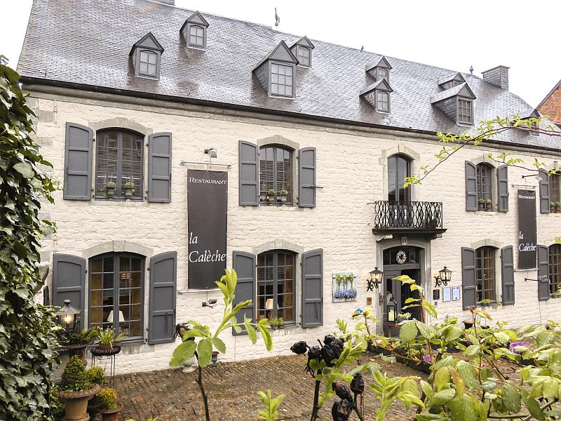 lovely hotel in Rochefort, Wallonia Region in Belgium, old facade of a hotel with shutters