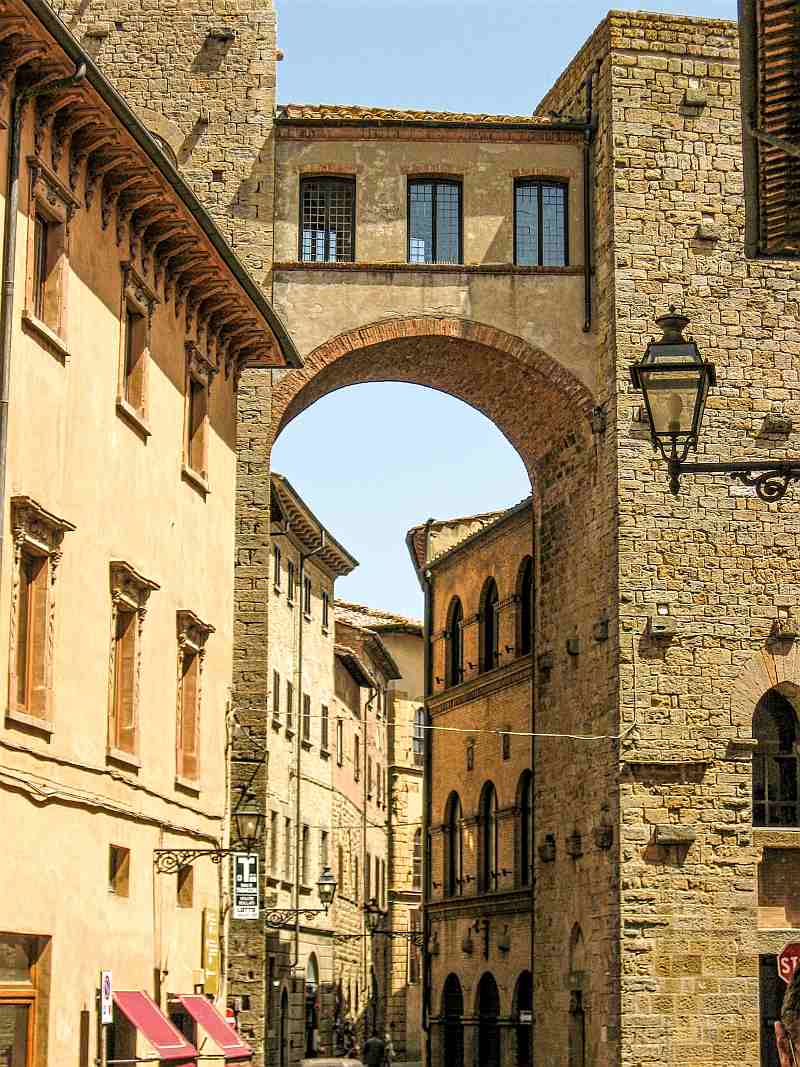 tower house connected with a vaulted arch, Buomparenti tower house in Volterra Tuscan Italy