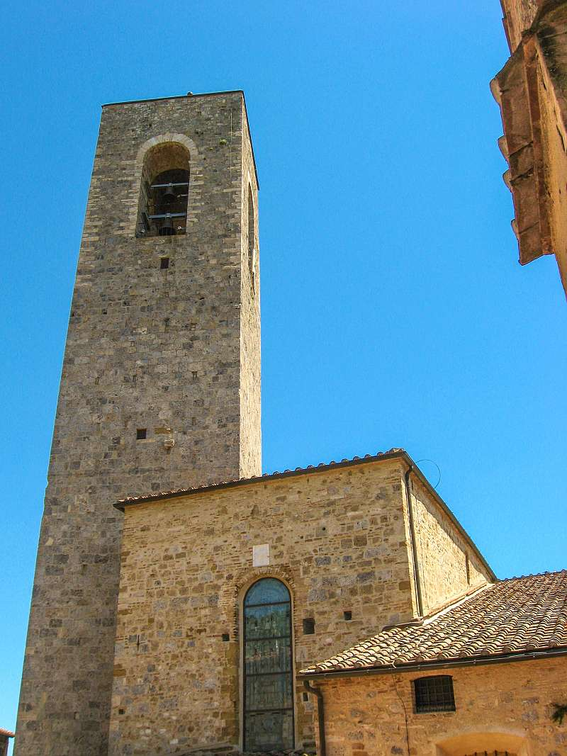 a bell tower of a medieval church in San Gimignano Tuscany