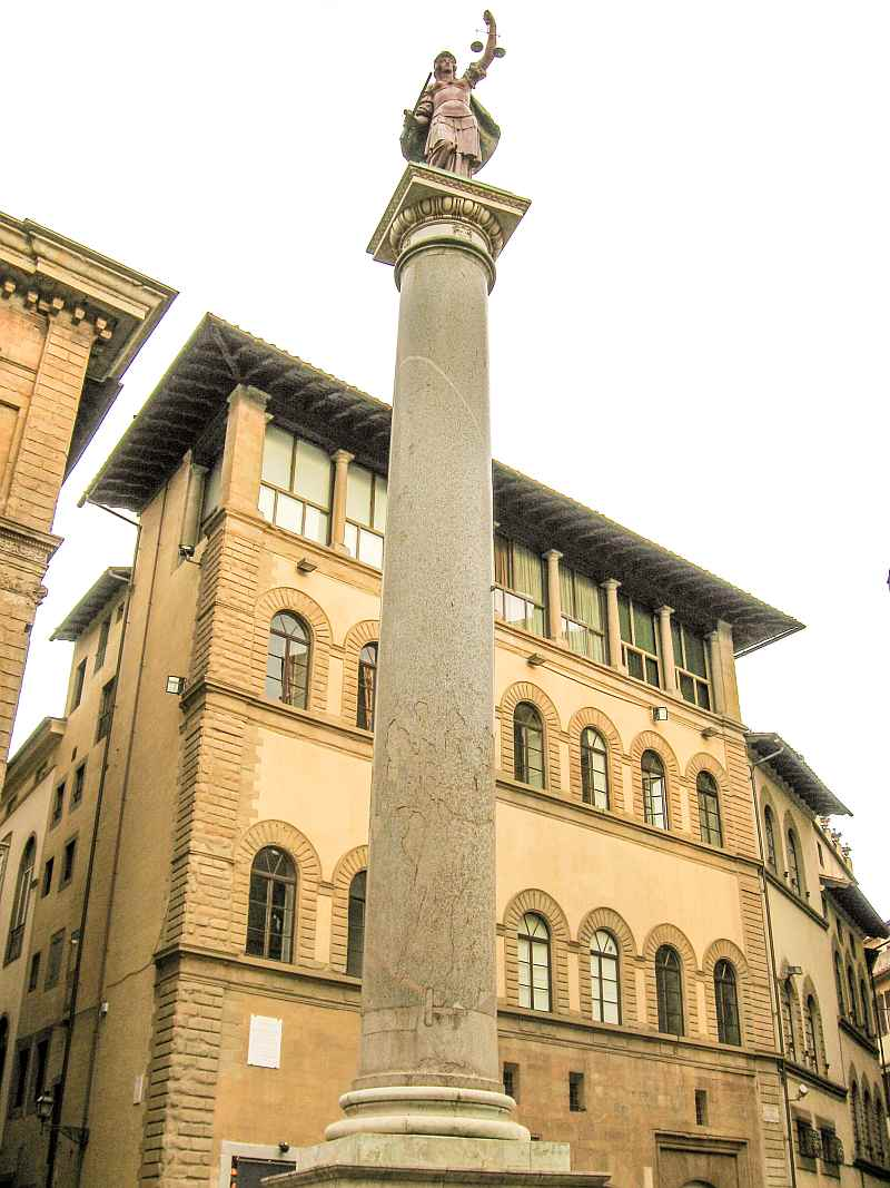 a tall column with a statue on top of it on a city square, Piazza di Santa Trinita with the Roman Column