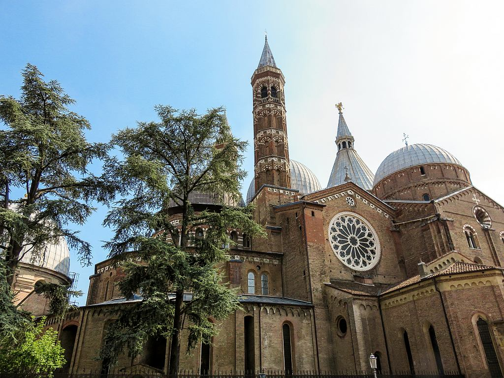 a church with blue domes and a church tower, the Saint Anthony Basilica in Padua