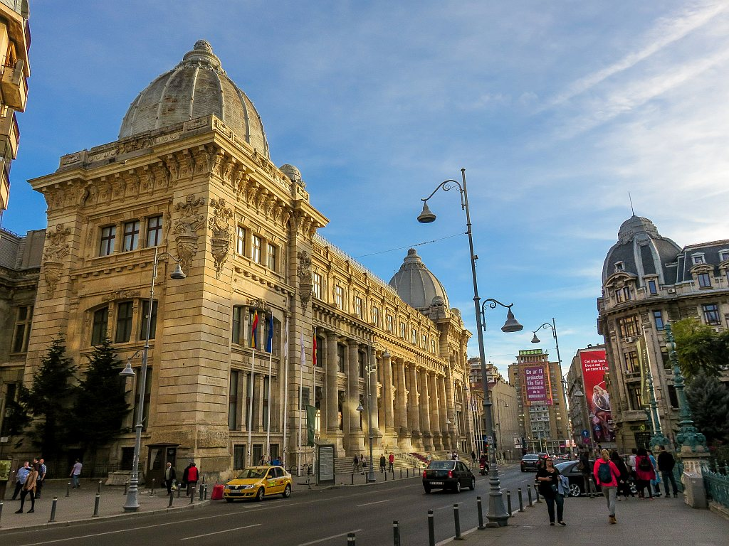 a beautiful building in Art Nouveau style and elegant lampposts; the National Museum of Romanian History in Bucharest