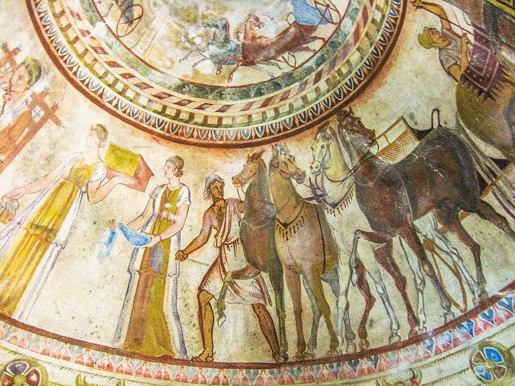 frescoes with chariots and horses on the inside of a round cupola, the Thracian Tomb in Kazanlak