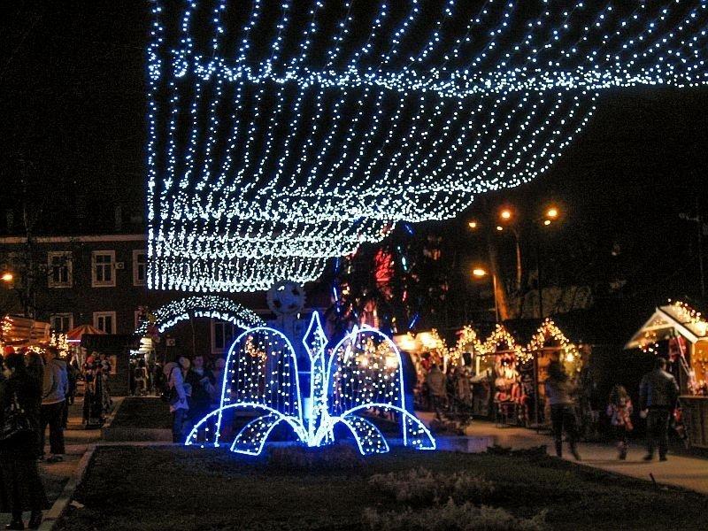 Christmas stalls on both sides with some hanging lights, the Christmas village in Veliko Tarnovo, Bulgaria
