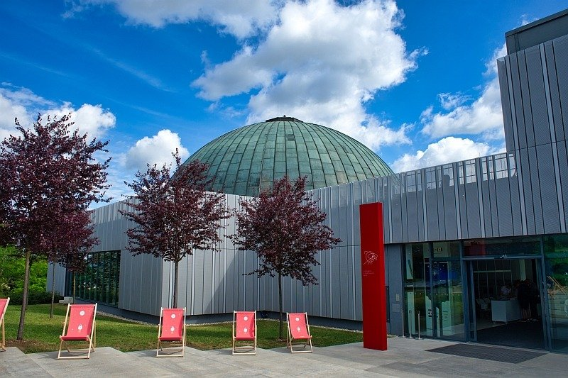 a modern building with a round greenish cupola, the planetarium in Brno
