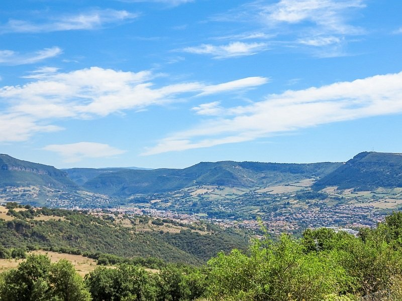 beautiful scenery with high plateaus and a town in the valley, France near Millau