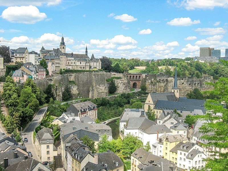 a view from the top to an old town along a bend of a river, Luxembourg Old TOwn UNESCO World Heritage Site