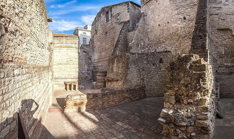 ruins of an old roman building, the Baths of Constantine in Arles