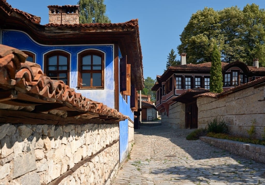 colorful houses lining up a cobblestone street, Koprivshtitsa in Bulgaria