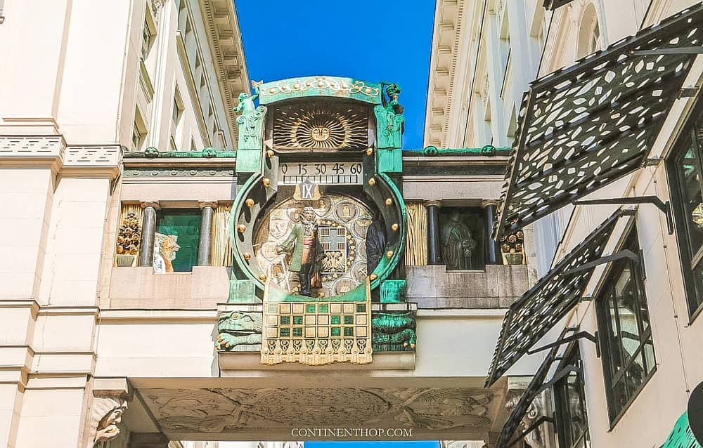 An interesting clock with figures on a small covered bridge between two buildings, the Anchor Clock in Vienna, Austria